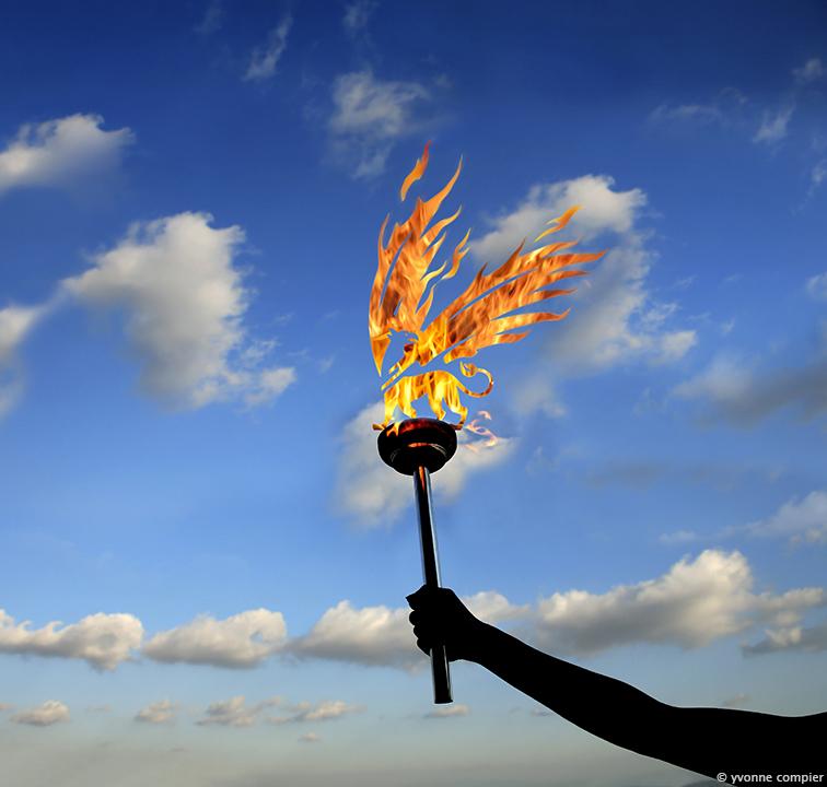 een foto voor een olympische advertentie van de Vu in het Parool. De griffioen als fakkel op een olympische torch, fakkel. Olympisch vuur tegen een achtergrond van blauwe lucht en wolken.